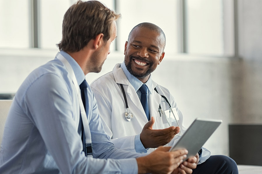 A physician confers with a consultant