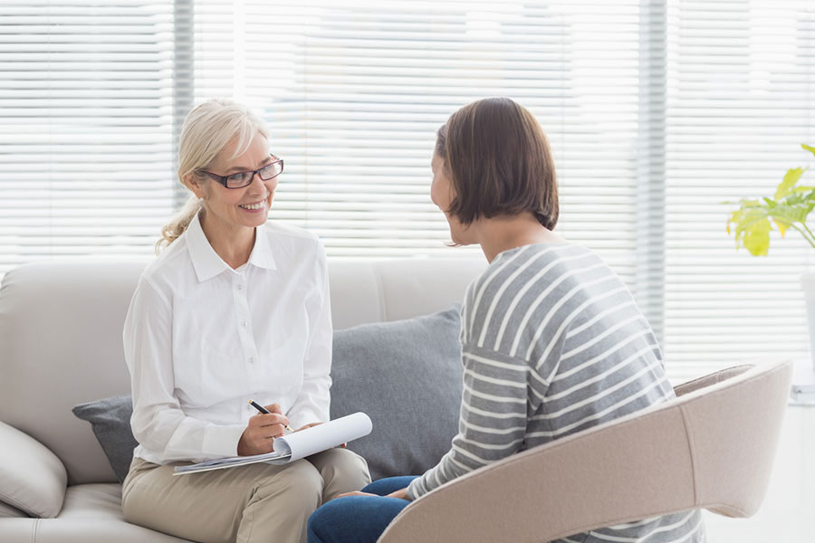 A therapist and her patient talk comfortably